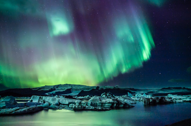 Northern lights by the glacial lagoon - Iceland
